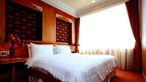 Amos Cozy Hotel Guest Room
